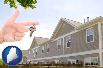 condominiums and a condo key with Maine map icon