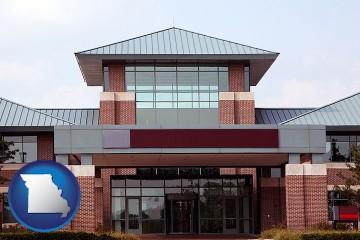 a condominium office building with Missouri map icon