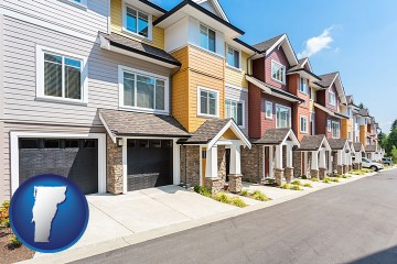 a row of townhouses with Vermont map icon
