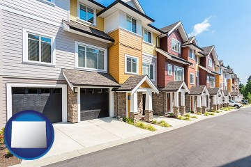 a row of townhouses with Wyoming map icon