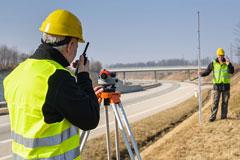 land surveyors surveying a highway