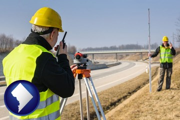 land surveyors surveying a highway with Washington, DC map icon