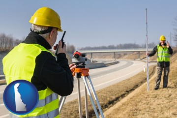 land surveyors surveying a highway with Delaware map icon