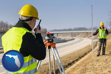 land surveyors surveying a highway with Florida map icon