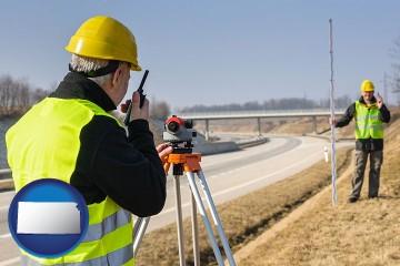 land surveyors surveying a highway with Kansas map icon