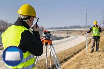 land surveyors surveying a highway with North Dakota map icon