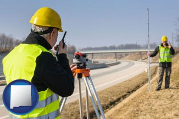 land surveyors surveying a highway with New Mexico map icon