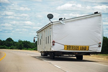 an oversize load mobile home being transported