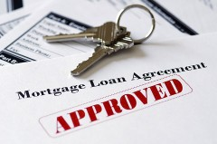 approved mortgage agreement with door keys