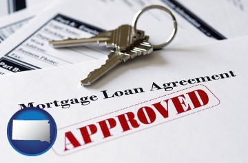 an approved mortgage loan agreement with South Dakota map icon