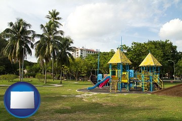 a tropical park playground with Colorado map icon