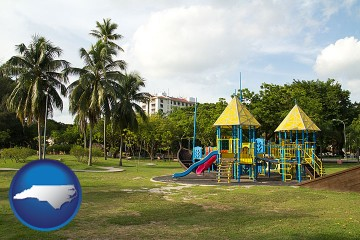 a tropical park playground with North Carolina map icon