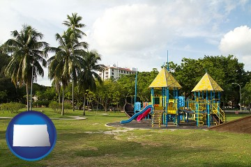 a tropical park playground with North Dakota map icon