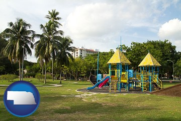 a tropical park playground with Nebraska map icon