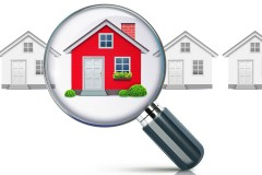 highlighted red house, seen through a magnifying glass