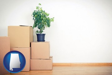 an unfurnished apartment with moving boxes with Alabama map icon