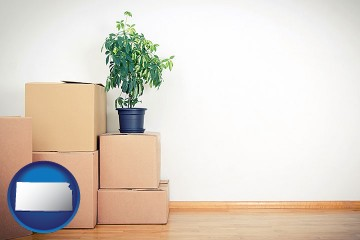 an unfurnished apartment with moving boxes with Kansas map icon