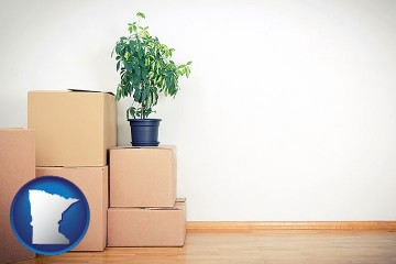 an unfurnished apartment with moving boxes with Minnesota map icon